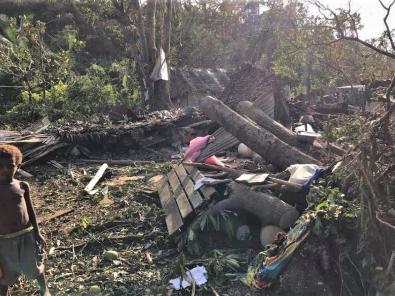 boy by vanuatu cyclone damage
