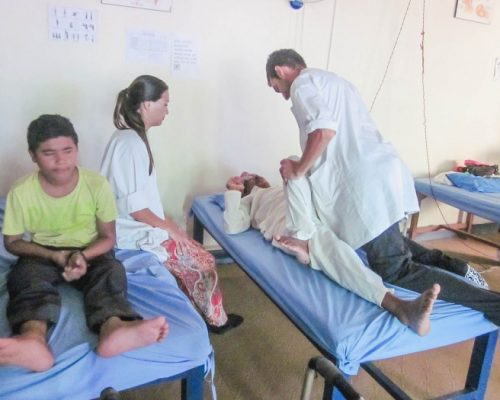 Physiotherapist intern assisting person in nepal
