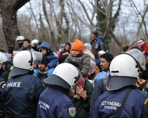 police patrol the greece refugee camp areas