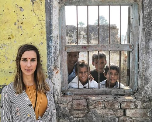 Amazing shot of el with kids behind bars in bodhgaya bodhi tree school volunteering
