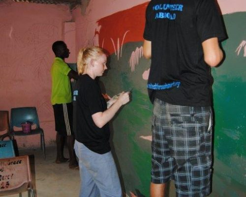 renovating a local school with painted wall