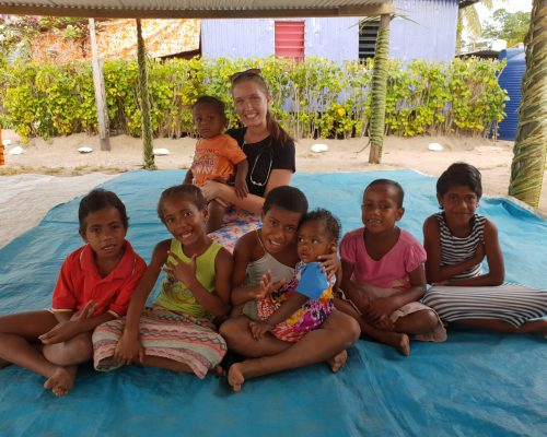 Beth franks with the children in the village in fiji