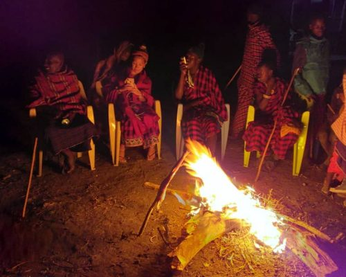 volunteers around bonfire in Tanzania