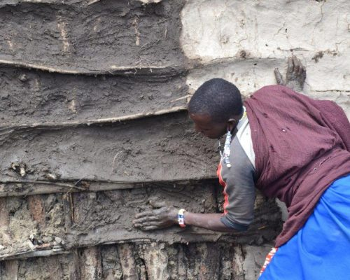 clay house building by a local Tanzania man