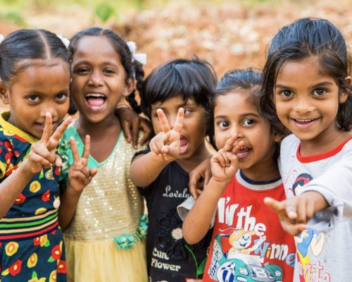 group of young kids smiling at camera