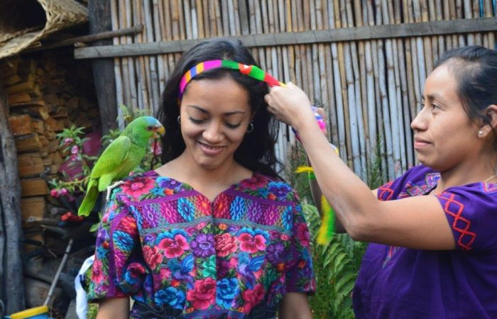 girl with parrot on her shoulder