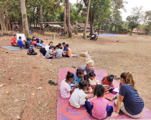 teaching outside on mat