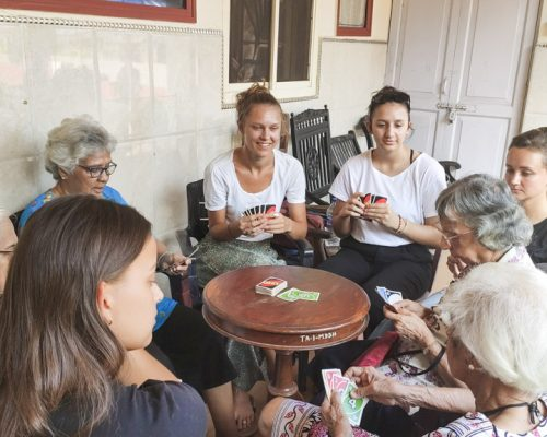 playing uno at elderly home