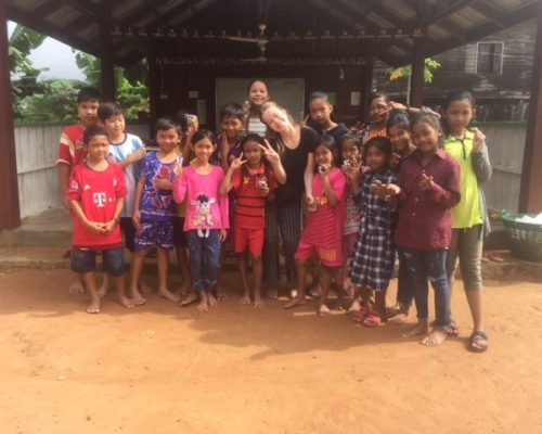Grace with the children at school in cambodia