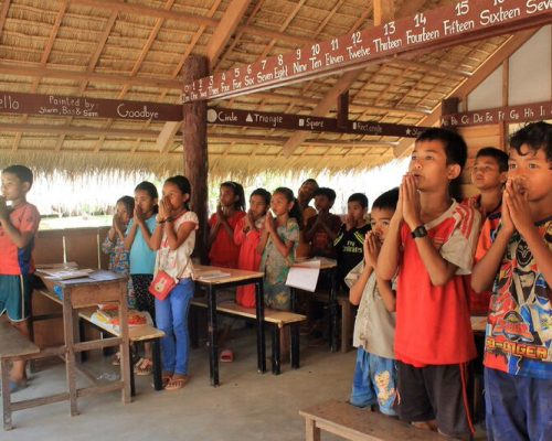 Children reciting daily prayer cambodia school