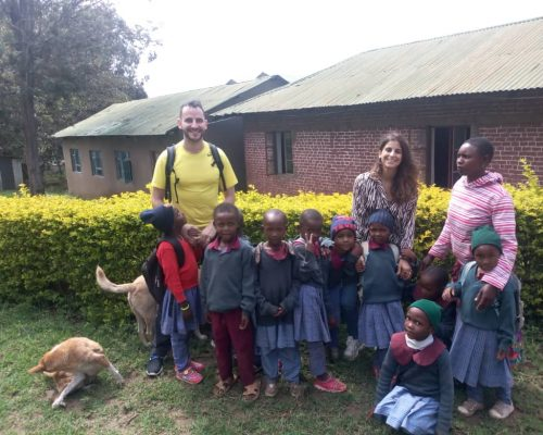 volunteers with Tanzanian students