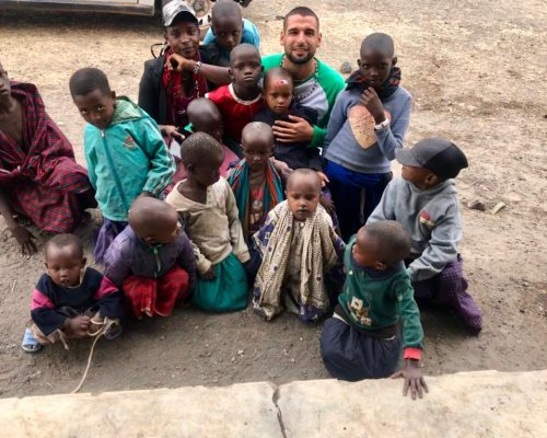 volunteers with group of kids in Tanzania