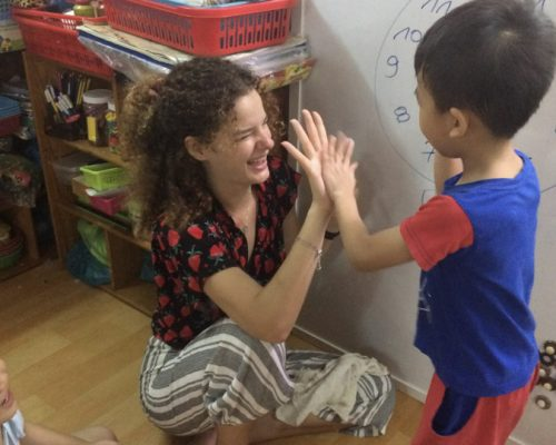 High five with kids-Ho Chi Minh
