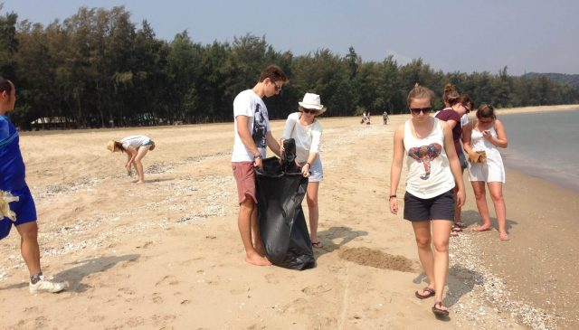 volunteers cleaning up the beach in thailand