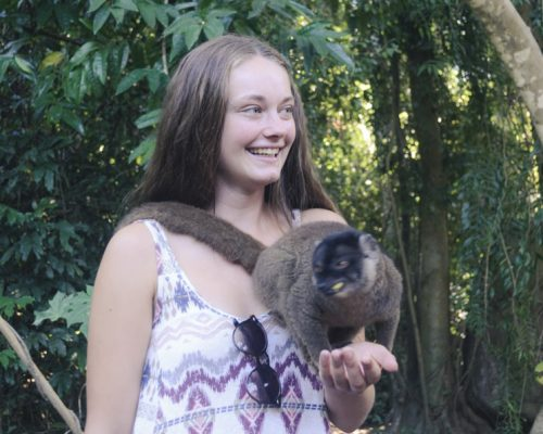 IVI volunteer holding lemur