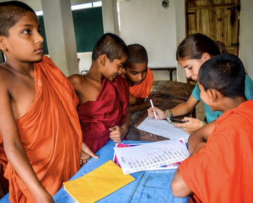 checking work in classroom