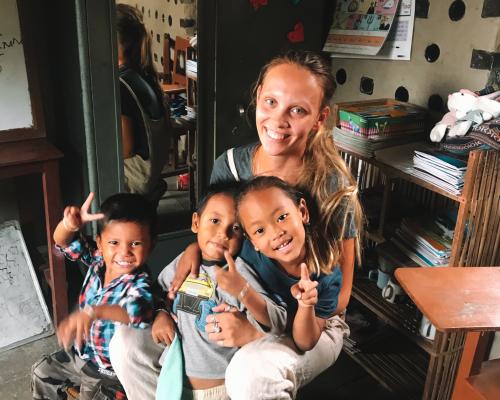 Kindergarten children with Georgina the IVI volunteer