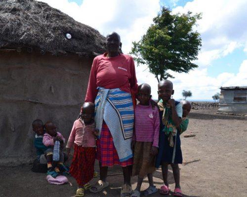 Maasai family outside hut in Tanzania