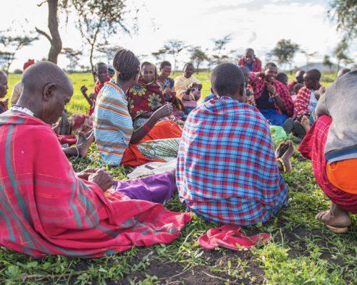Making beaded Maasai