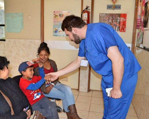 doctor shaking hand of young boy