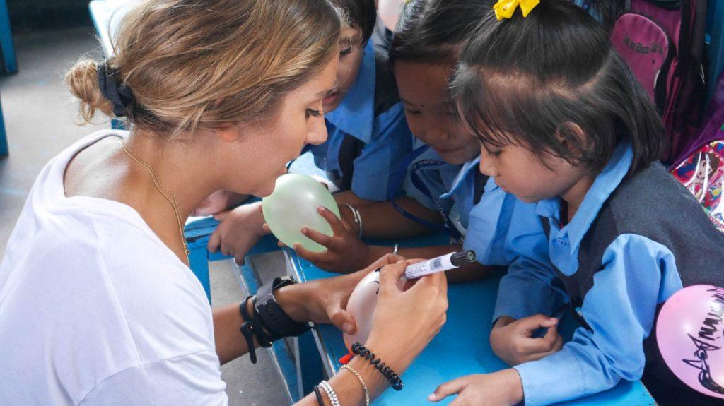 IVI Volunteer teaching Nepalese Children