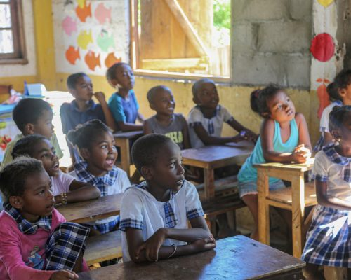 kids at desks in classroom