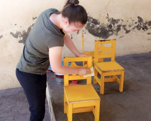 Painting student chairs and tables-
