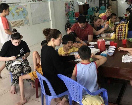 IVI volunteer feeding a child