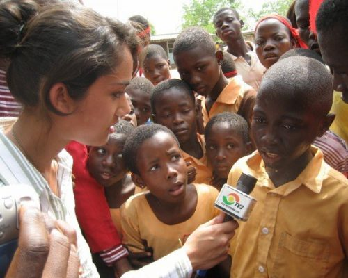IVI volunteer interviewing a student