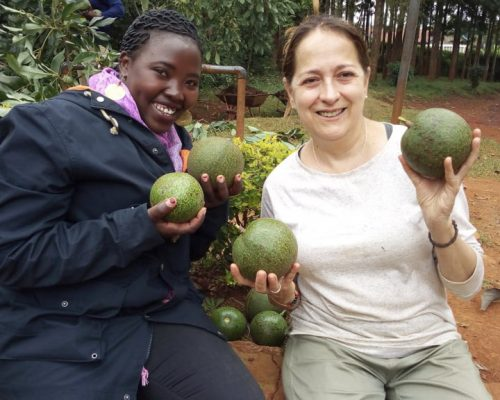 Participant posing with big avocadoes