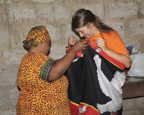 Participant receiving a gift from a teacher (1)