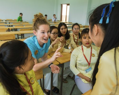 IVI Participant talking with students