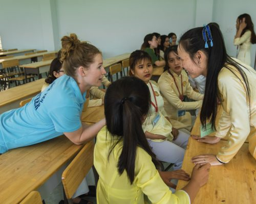 Participant talking with students- ivi volunteering