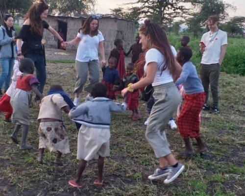 Participants playing with maasai children
