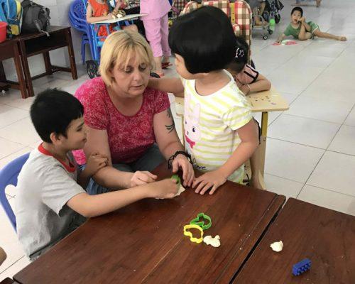 Participants teaching children making Play Dough