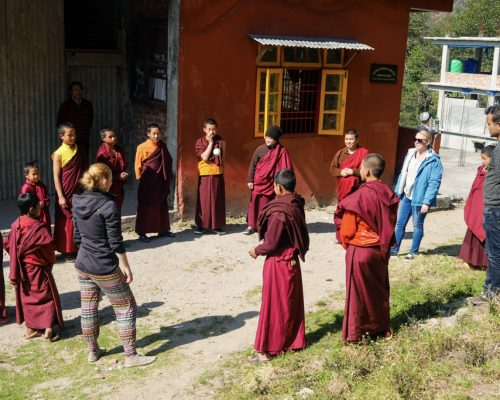 standing in a circle with the monks