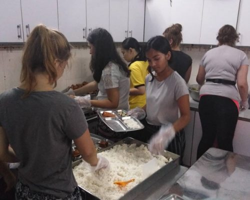 Preparing food IVI volunteers