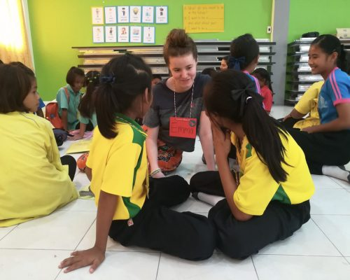 sitting on the floor teaching in groups