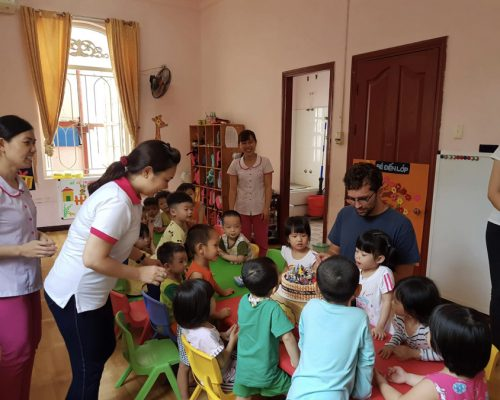 Serving a cake to the kids-Ho Chi Minh