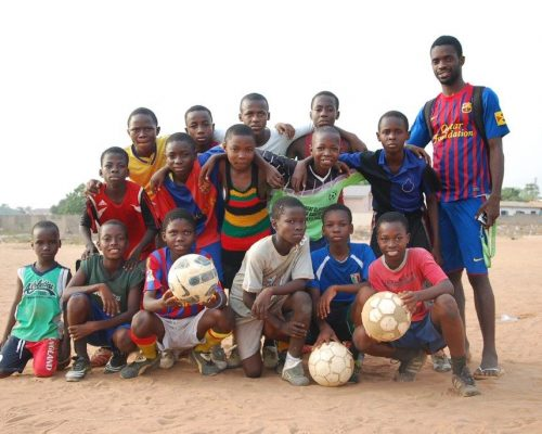 group of local Ghanaian kids on football team