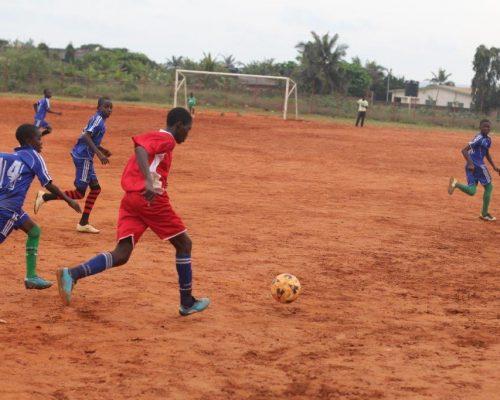 teaching children on football skills