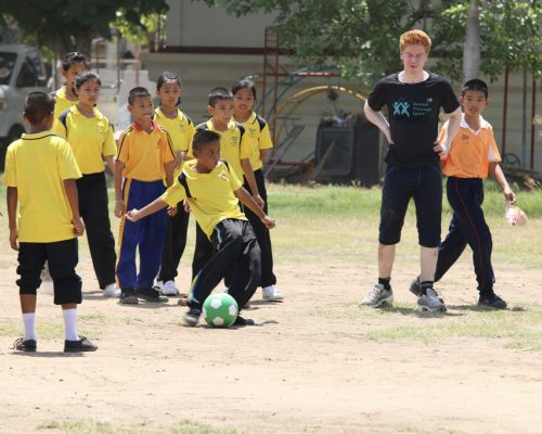 Student playing football