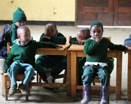 small children at school desk, Tanzania