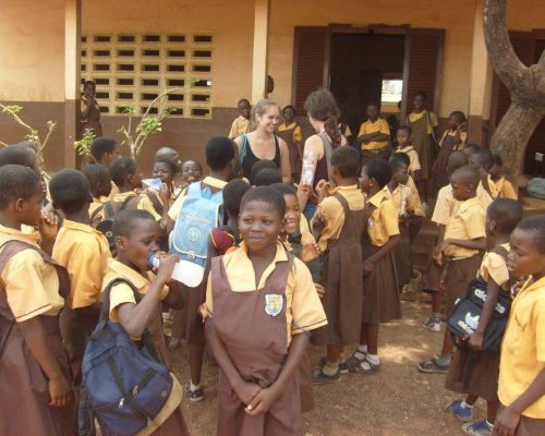 class standing outside school in Ghana