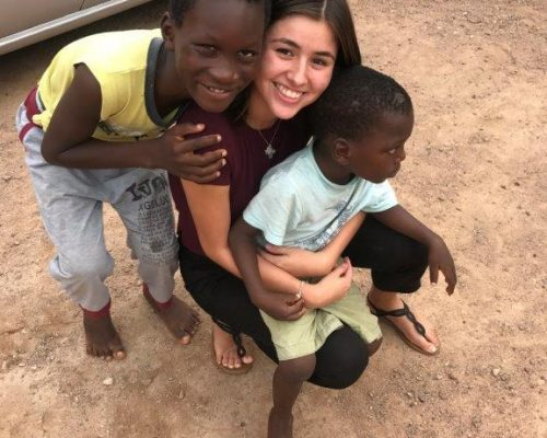 holding children on Ghana project