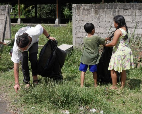 children cleaning rubbish