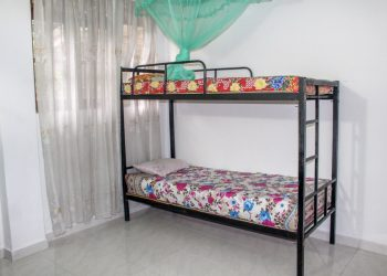 a bed with a mosquito net (Kandy)