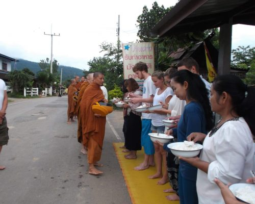 buddhists lining up for daily rations