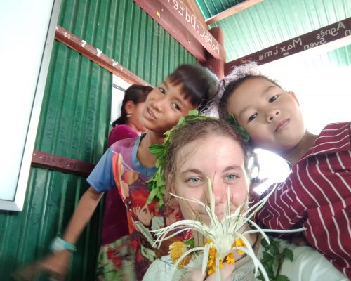 cambodia children with jordyn volunteer and weird corn thingy