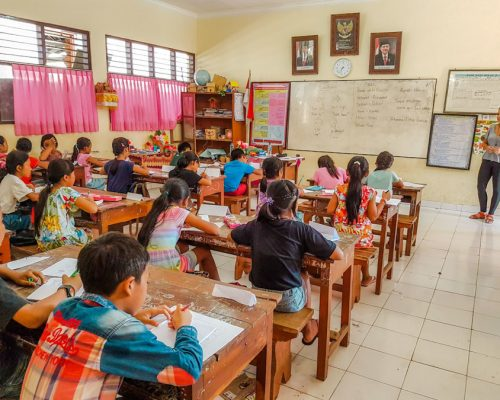 children at classroom desks working